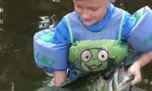 Boy Reels in Huge Largemouth Bass