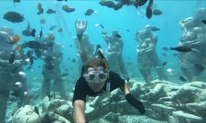 Couple Snorkel Together Through Famous Underwater Statues