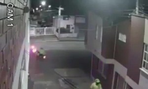 Police Officers Accost Cyclist in Alleyway