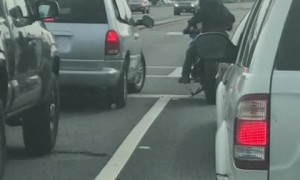 Motorcyclists Mangles Mirror