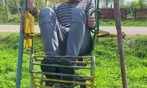 Grown Man Flips in Kid's Swing