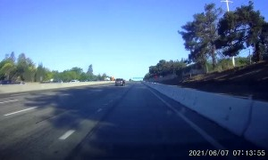 Highway Collision Causes Truck to Overturn