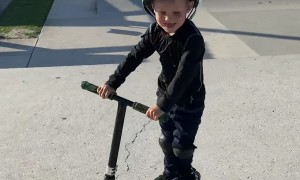 Young Scooter Rider Lands Tail Whip