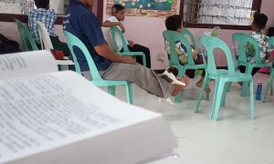Guy in Church Swings Puppy with His Feet