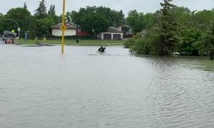 Husband Crosses Flood Kayaking Off Bucket List