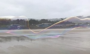 Incredible Giant Bubble Stretches Along Beach