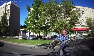Man Attacks Car with Bicycle