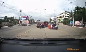 Driver Narrowly Avoids Fallen Riders on Road