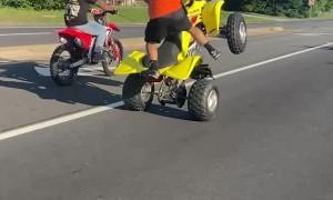 Man on Yellow Four-Wheeler Pulls Impressive Stunts
