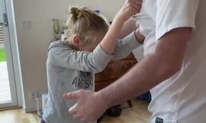 Girl with brain disease incredibly dances hands-free with her dad
