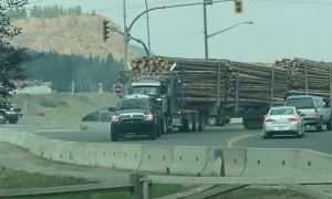 Loaded Logging Truck Towed By Powerful Pickup Truck