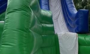 Kid Accidentally Front Flips Down Bouncy Slide