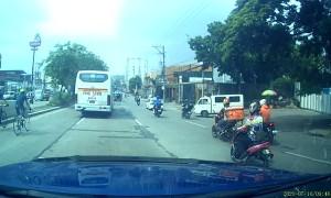 Oblivious Bicyclist Bumps Into Bus