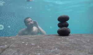 Diver Uses Bubble Ring To Tumble Rocks