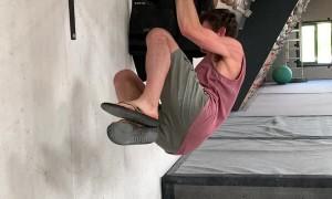 Rock Climber Practicing One Finger Hang