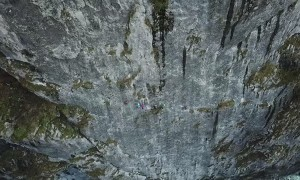 Group of Climbers Scale Cliffside
