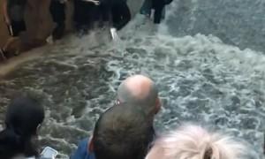Passengers Flee as Flooding Flows Down Metro Stairs