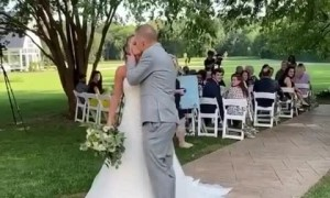 Newlywed couple falls after attempting a romantic kiss