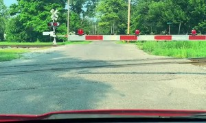 Pleasant Surprise for Disappointed Driver at Train Crossing