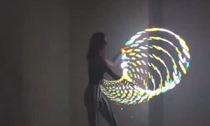 Talented girl performs incredible tricks with LED hula hoop