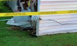 Car Drove Through House