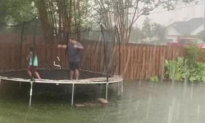 Family Turns Flooded Backyard into Canoe Fun
