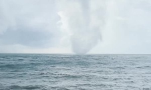 Beautiful Tornado Comes From the Ocean and Crashes into Shoreline