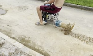 Construction Worker Takes Asphalt Compactor for a Drive