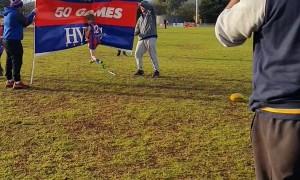 Boy Bounces Off Aussie Rules Football Celebration Banner