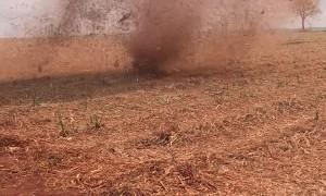Dust Devil Drifts Across Field