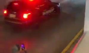 Police Car in Pursuit of Rollerblader