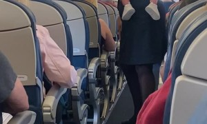 Flight Attendant Calms Fussy Baby