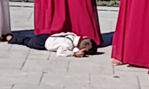 Tired Ring Bearer Takes Nap on Pillow After Successful Delivery