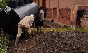 Worker Takes a Tumble While Carrying Equipment
