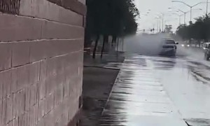 Pedestrian Showered by Passing Pick-up Truck
