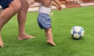 Dad & special needs son have fun playing soccer together