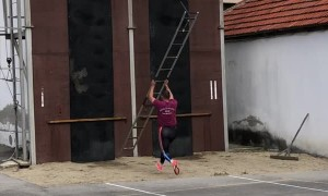 Man Deftly Ascends Building With Ladder