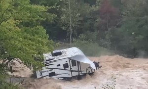 Camp Trailer Stuck in River Flood Waters