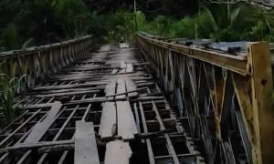 Scooter Crosses Sketchy Bridge