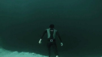 A Man Jumps Into A 700ft Underwater Chasm