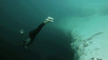 This Spectacular Underwater Jump Into The Deep Blue Sea Will Leave You Breathless!