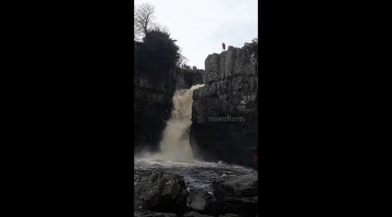 Adrenaline junkie flings self down waterfall during UK floods