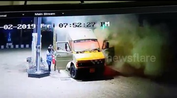 Incredibly brave men push truck on fire away from petrol station