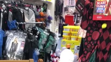 Boy Isn't Scared of Clown Decoration in Halloween Store