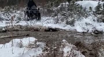 Man Flies Over ATV Handlebars After Hitting Mud Hole
