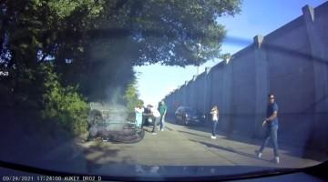 Upside-Down Car Slides Down Roadway