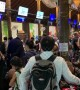 Chaos in Thai airport as stranded tourists rush to leave islands