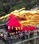 99-metre-long dragon dances on glass bridge to celebrate two world records having been created