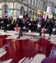 Climate activists throw 'blood' outside Downing Street