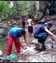 Residents bath in river stream amid nationwide blackouts in stricken Venezuela